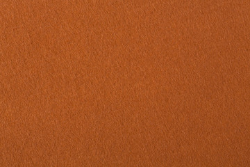 Texture of brown felt.