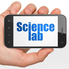 Science concept: Hand Holding Smartphone with Science Lab on display