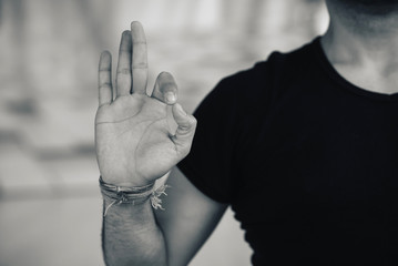 Closeup of mans hand in yoga meditation pose