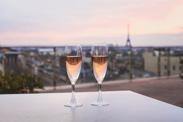 drinking champagne in luxurious restaurant in Paris, France