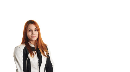 Handsome red head girl portrait in moto equipment on neutral white background. Femail biker shot. Copy space for advertising motorcycle