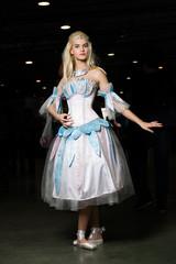 Young woman cosplayer wearing beautiful dress posing