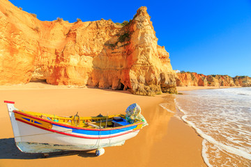 Fishing boat on a Praia da Rocha in Portimao, Algarve region, Portugal