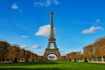 Eiffel tower over blue sky. Sunny autumn day in Paris