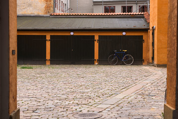 Racing bicycle parked in front of the garage, Copenhagen, Denmark