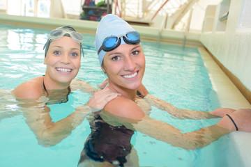 two women in the swimming pool