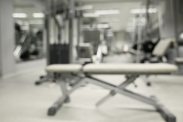 Gym interior with equipment, blurred background
