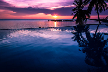 Sunset by infinity pool in Koh Phangan, Thailand