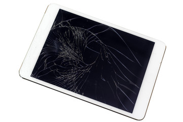 Tablet computer with broken glass screen on white background, in