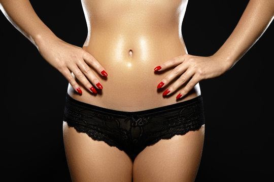 Waxing for beautiful woman. Brazilian laser hair removal bikini line an sexy body shapes. Close-up of sexy female wearing black lace panties. Body care and clean skin