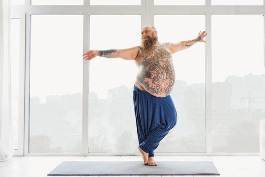 Man doing exercises on a yoga mat