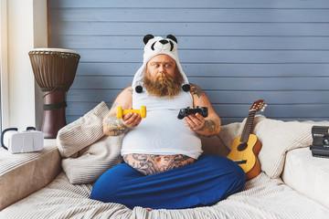 Man making choice between exercising and playing video games