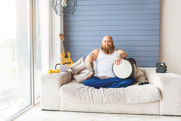 Confident thick guy playing musical instrument