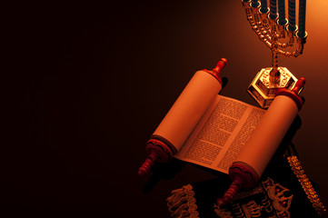 Religion and Judaism concept with candle lit scene of the holy Torah and a menorah with copy space Wall mural