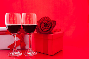 St Valentine's setting with present and red wine