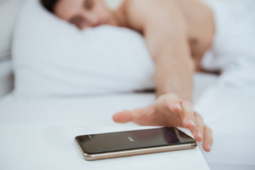 Cropped image of Man lying on bed
