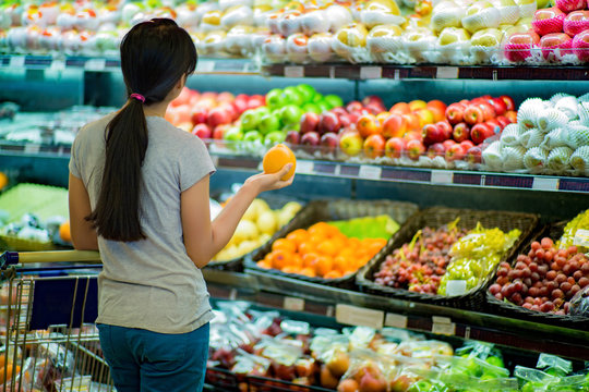 Woman are choosing fruit in supermarkets