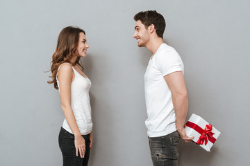 Side view of couple with gift