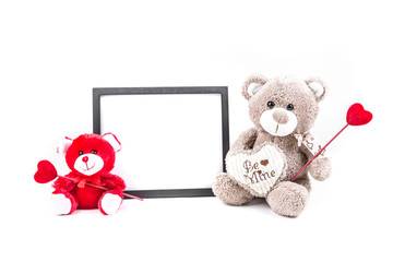 Valentine bear with a black picture frame isolated on a white background