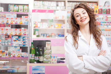 Smiling pharmacist looking at camera inside a drugstore