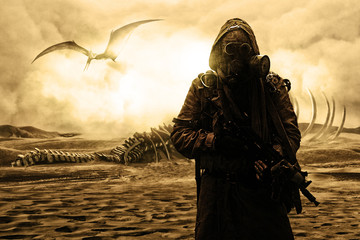 Nuclear post apocalypse. Life after doomsday concept. Grimy survivor with homemade weapons and gas mask. Desert and dead wasteland on the background Wall mural
