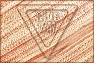 give way sign on wooden board
