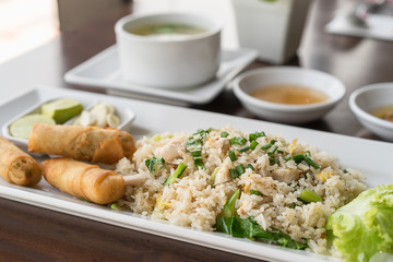 Fried rice with salted fish and fried spring rolls.