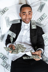 Vertical image of African man throws the money