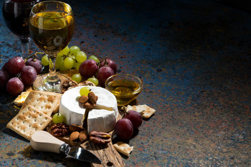 Camembert cheese, snacks and glasses of wine