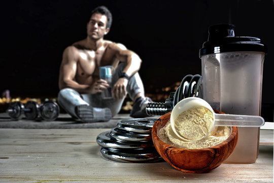 Protein shake Vanilla flavor accompanied by weights and sportsme