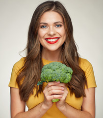 portrait of young smiling woman with vegetables