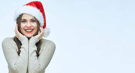 Smiling woman portrait with christmas hat.