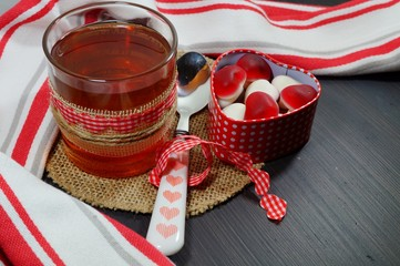 Valentine's concept. Heart shaped box, cakes and candy in the shape of hearts and tea