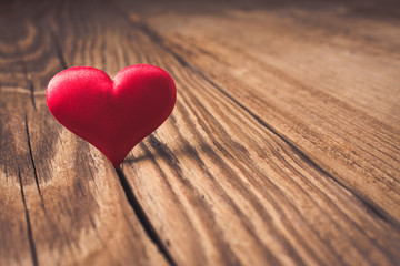 Valentines day. Red heart on wooden background. Copy space