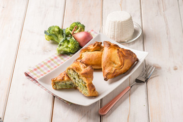 oven panzerotti with broccoli and ricotta cheese