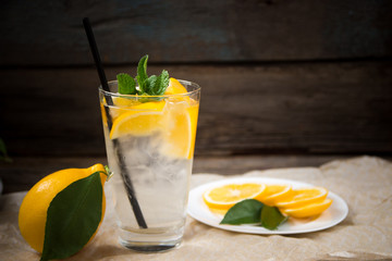Fresh lemonade in glass with mint and ice