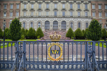 The fence of the Royal Palace with crown in Stockholm, Sweden