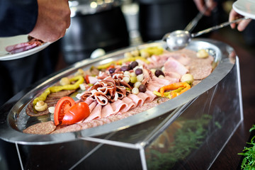 Charcuterie in self service all you can eat buffet plate.