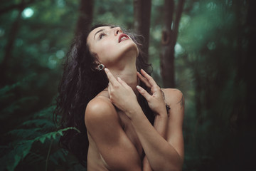 Beautiful woman free in the forest
