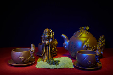 Still life with a statuette of the god of tea
