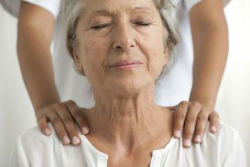 Senior woman getting a shoulder massage
