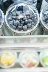 Fresh blueberry berries in plastic container