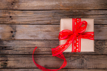 Box with red Ribbon Hearts.Gift for the Holiday.On vintage wooden background.Vintage style.  top view. Copy space.selective focus.