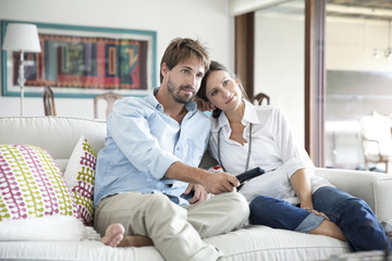 Couple watching TV together