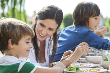 Family enjoying healthy meal outdoors