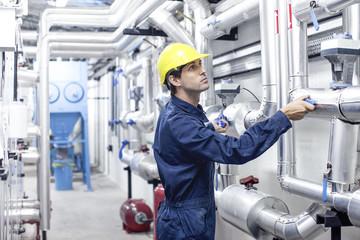 Engineer working in industrial plant