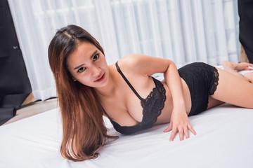 Asian woman in bikini on bed, woman on bed