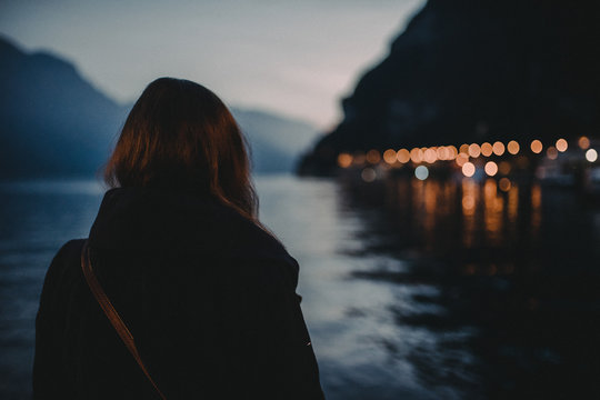 Woman looking over lake Garda