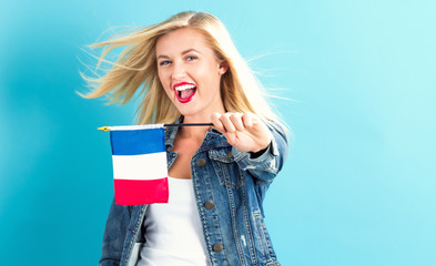 Young woman holding French flag Wall mural