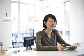 Japanese businesswoman working in an informal office environment
